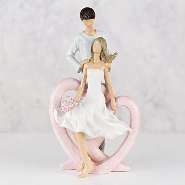 Resin Figurine - Man Holding Lady with Flowers