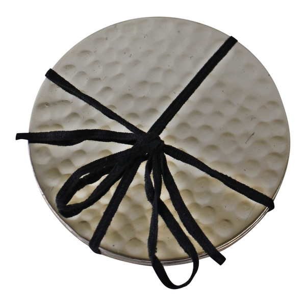 Set Of Four Hammered Silver Coloured Coasters